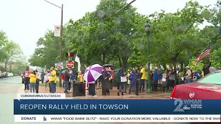 Baltimore County residents take part in reopen rally on Friday in Towson