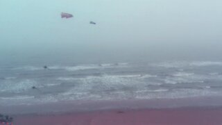 Drone footage captures kite flying on a foggy day in Texas
