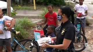 Martin County Sheriff's Deputies distribute free gifts to local children
