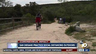 San Diegans practice social distancing outdoors