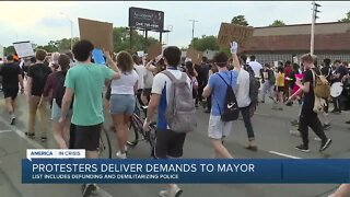 Protesters deliver demands to mayor