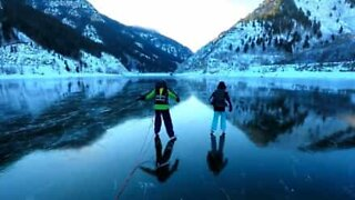 Family ice skates in beautiful landscape