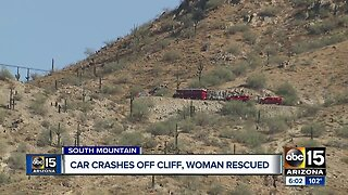 Car crashes off cliff, woman rescued