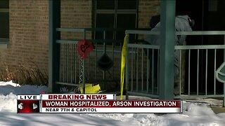 Woman hospitalized, arson investigation