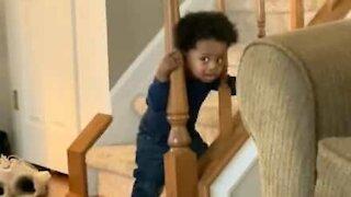 Baby gets head stuck between staircase railings