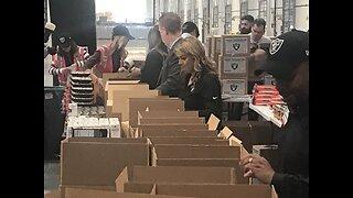Raiders alumni pack Thanksgiving food boxes for Las Vegas charities
