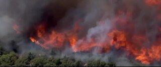 'Bush fire' forces evacuations, burning 64k acres