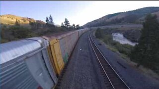 Drone races moving freight train