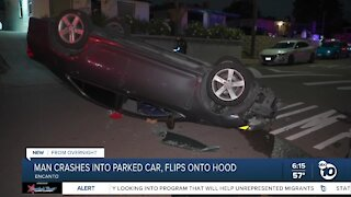 Driver crashes into parked car, flips own car onto hood