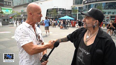 Jamie from the Pushing Inc. Tattoo Emporium speaks at Dundas Square