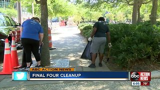 Volunteers clean along Rverwalk in preparation for the NCAA Women's Final Four Championship