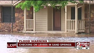 Checking on levees in Sand Springs