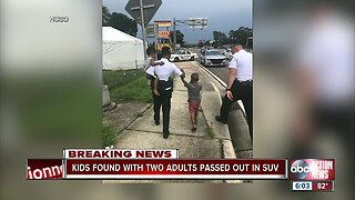 Young children found in vehicle with unconscious adults at major Hillsborough intersection: Deputies
