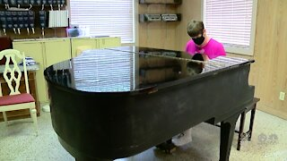 Braille club volunteer plays piano for others