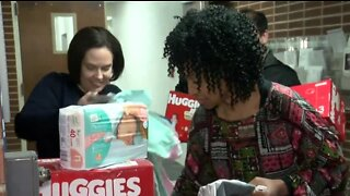 Local corporation collects items for Community Baby Shower