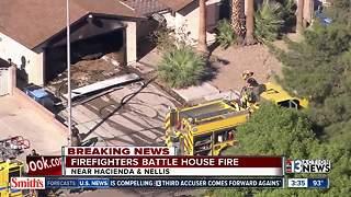 Firefighters battle house fire near Hacienda, Nellis