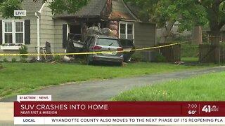 SUV crashes into home
