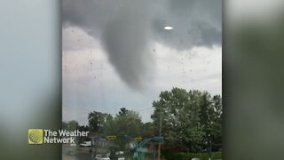 Tornado spins right outside the window