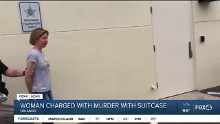 Woman charged with murdering boyfriend with suitcase