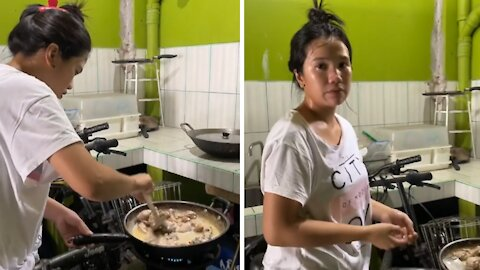 Woman gets hilariously pranked while she's cooking