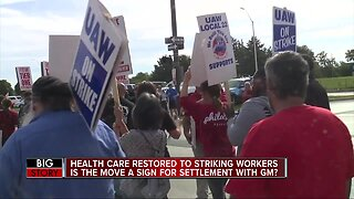 GM reinstates health care benefits for striking UAW members