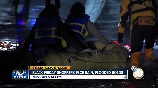 Shoppers rescued after driver gets stuck in flooded street