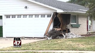 Car crashes into house in South Lansing