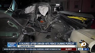 4 hurt after truck in pursuit hits fence
