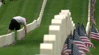 Honoring the fallen: Group takes Memorial Day road trip to place 1,600 flags on gravesites
