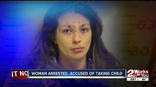 Woman arrested, accused of taking child