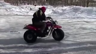 Guy performs amazing side spin trick on 3-wheeler