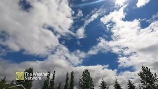 Timelapse shows clear blue skies turn into gloomy storm clouds