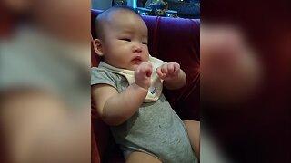 Baby has First Taste of Apples