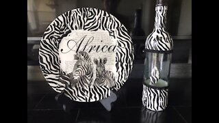 Plate and bottle decorated with African scene