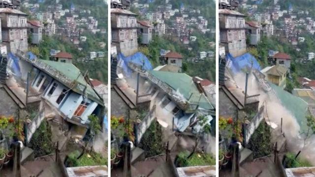 Skremmende: Huset forsvinner ned skråningen på sekunder