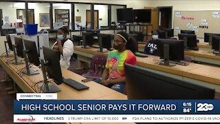 High school senior pays it forward