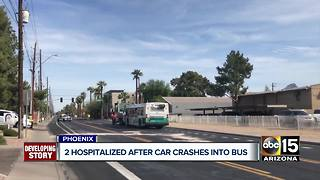 Two hospitalized after car crashes into Phoenix bus