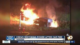 Crews restoring power after car fire