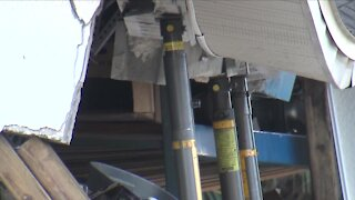 Driver confirmed dead after vehicle crashes into garage