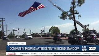 Community mourns after deadly weekend standoff