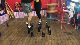 Circus artists walk on glass bottles