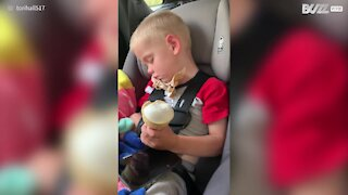 Kid dozes off while eating ice-cream