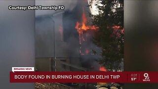Body found inside burning home in Delhi Township