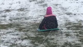 Grandfather takes the huff and puff out of sledding