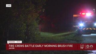 Crews battle early morning brush fire near Jupiter Farms Park