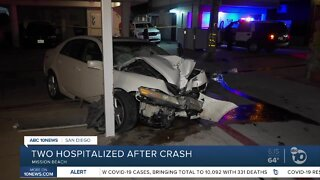 Car crashes into support beam, 2 people hurt