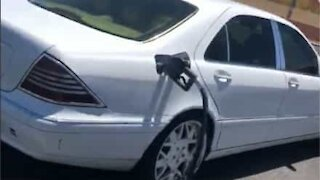Driver spotted with hose plugged in car
