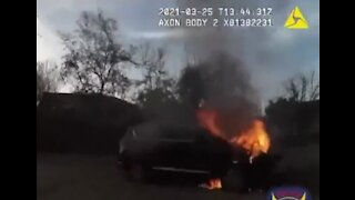 Video: AZ police officer rescues person from SUV fire