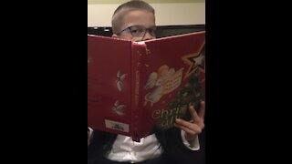 Gifted Child plays Silent Night on the piano
