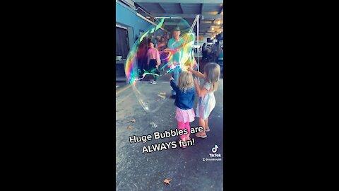 Huge bubbles slow mo pop